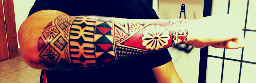 Carl Cocker Polynesian Forearm Tattoo